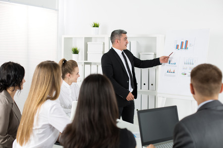 management team: Business people meeting in office to discuss project. Business success concept Stock Photo