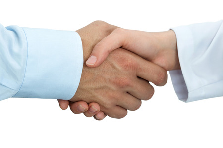 to trust: Female medicine doctor shaking hands with male patient. Partnership, trust and medical ethics concept. Handshake with satisfied client. Healthcare and medical concept