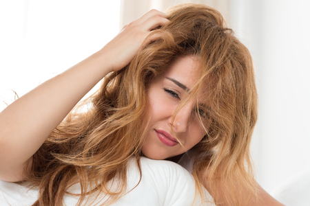 tousled: Young tousled woman waking up early in the morning