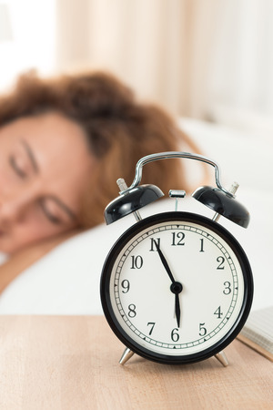 well  being: Beautiful happy woman sleeping in her bedroom in the morning. Well being and healthy sleeping concept.