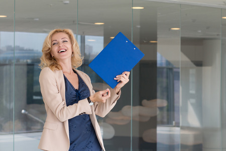 gente che balla: Happy excited business woman celebrating and dancing in her office Archivio Fotografico