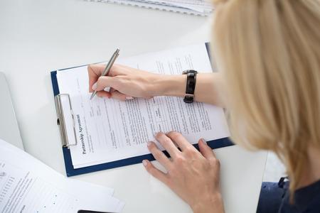 partnership: Business woman filling partnership agreement blank. Business and partnership concept Stock Photo
