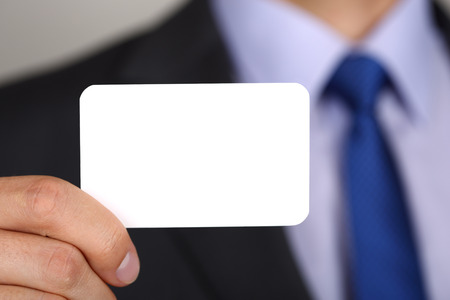 copyspace: Close up of businessman hand showing business card. Copyspace. Stock Photo