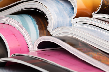 printed: Close-up of stack of colorful magazines
