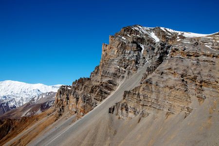 treck: One of the peaks on Thorong La mountain pass, morning view. Annapurna Circuit Treck, Himalayas, Nepal.