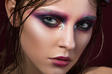 Beauty portrait of a young girl with fashion creative make-up. Colourful smoky eyes. Beauty face Stock Photo