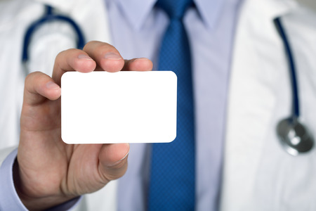 hand business card: Close up of doctors hand showing white business card. Healthcare and medical concept