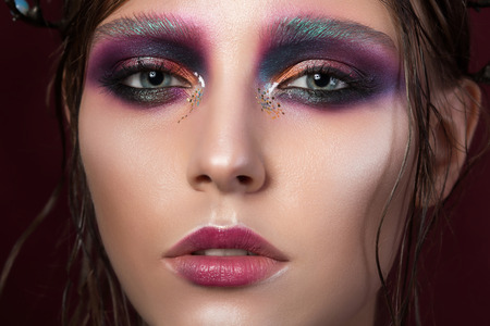 fashion art: Beauty portrait of a young girl with fashion creative make-up. Colourful smoky eyes. Beauty face Stock Photo