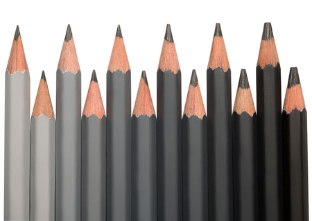 hardness: Row of black graphite pencils with different hardness colored from light grey to black.