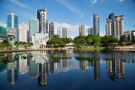 water scape: Kuala Lumpur, Malaysia - January 30, 2016: The KL City Centre Park in Kuala Lumpur, Malaysia. View on modern skyscrappers.