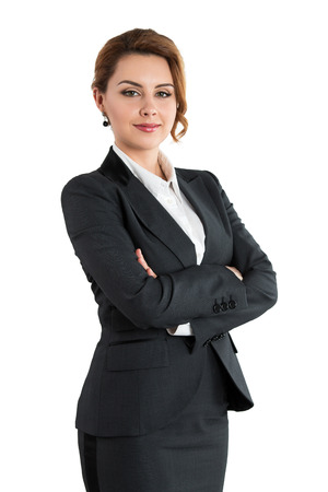 folded hands: Portrait of smiling business woman with folded hands isolated on white background. Female wearing grey formal suit standing with her arms crossed. Business lifestyle and success concept Stock Photo
