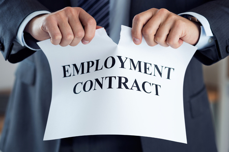 Close up of businessman hands breaking employment contract. Boss dismissing an employee. Bankruptcy, redundancy and getting fired concept. Employee loosing job or failing interview. Human resources Archivio Fotografico