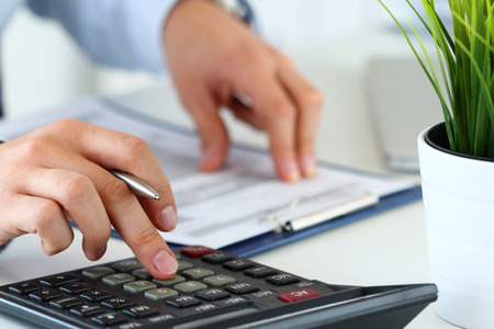 Close up view of bookkeeper or financial inspector hands  making report, calculating or checking balance. Home finances, investment, economy or insurance concept