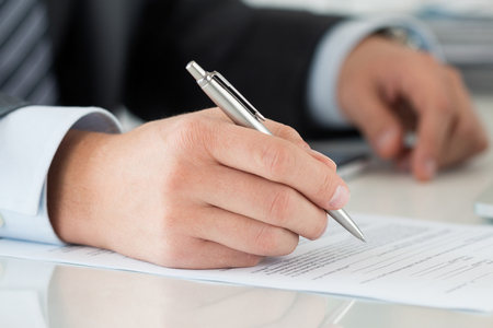 contact sheet: Close-up of businessman hands signing documents. Man writing something sitting at his office. Partnership agreement of contact signing, closing balance or making financial report concept