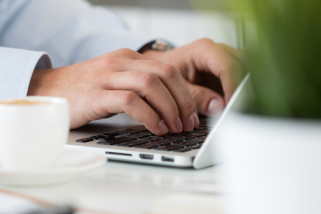 blogs: Close up view of businessman, designer or student hands working on laptop. Online distant education, writing blog, freelance, mobile payments, working at office or at home concept.