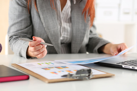 Businesswoman looking at graphics. Manager or auditor reading reports. Financial planning, business analysis and project management concept. Stock Photo