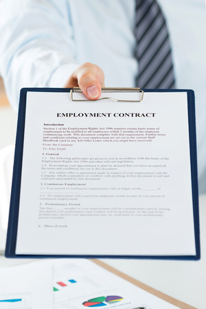 new recruit: Close up view of human resources manager offering employment contract to candidate. New job, collaboration and new opportunities concept Stock Photo
