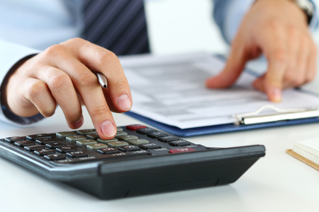 taxes budgeting: Close up view of bookkeeper or financial inspector hands making report, calculating or checking balance. Home finances, investment, economy, saving money or insurance concept
