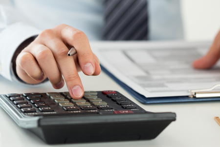 audits: Close up of male accountant or banker calculating or checking balance. Bookkeeper or financial inspector making financial report. Home finances, investment, economy, saving money or insurance concept