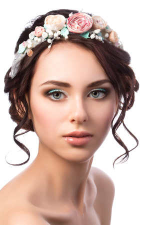 coiffure: Portrait of young beautiful bride. Wedding coiffure and make-up. Studio shot Stock Photo