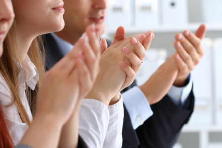 business conference: Close up view of business seminar listeners clapping hands. Professional education, business meeting, presentation or coaching concept