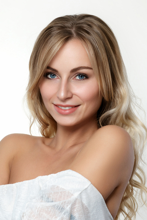 Portrait of beautiful blonde woman over white background. Skincare, spa, wellness and lifestyle concept. Studio shot. Stock Photo