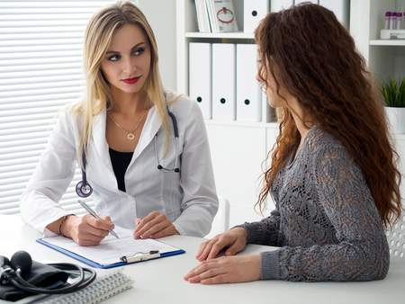 Doctor consulting her female patient. Patient sitting at doctor office. Diagnostic, prevention of women diseases, healthcare, medical service, consultation or education, healthy lifestyle concept