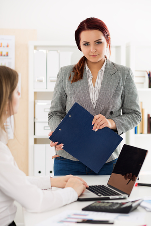 Internal revue service officer or auditor ready to check financial documentation. Portrait of businesswoman holding clipboard. Bookkeeping, accounting, taxes and financial planning concept Stock Photo