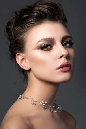 bridal salon: Portrait of young beautiful woman with bridal makeup and coiffure. Modern smokey eyes make up. Studio shot. Salon make-up Stock Photo