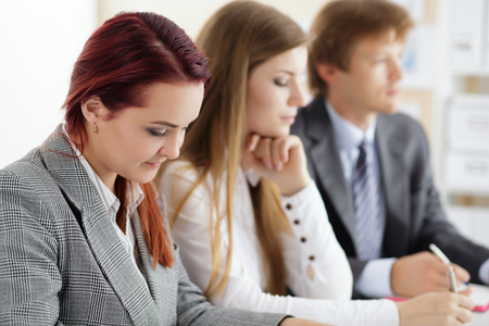 Students or businesspeople hands writing something during conference. Business meeting, blogging or professional education concept photo