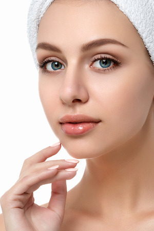 Portrait of young beautiful caucasian woman touching her face isolated over white background. Cleaning face, perfect skin. SPA therapy, skincare, cosmetology, hair removal or plastic surgery concept Stock Photo - 93529279