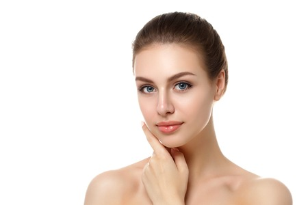 Portrait of young beautiful caucasian woman touching her face isolated over white background. Cleaning face, perfect skin. SPA therapy, skincare, cosmetology, hair removal or plastic surgery concept