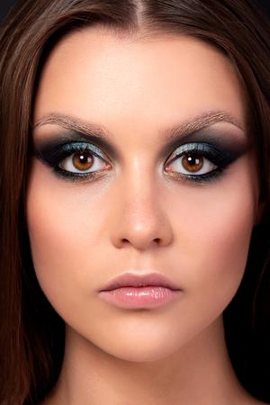 Portrait of beautiful woman with fashion makeup. Modern fashion makeup. Colorful smokey eyes. Studio shot