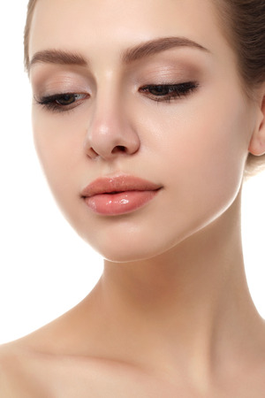 Close up view of young beautiful caucasian woman isolated over white background. Lips contouring, SPA therapy, skincare, cosmetology and plastic surgery concept
