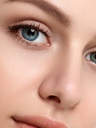 Close up beauty portrait of young caucasian woman. Cleaning face, perfect skin, skincare and cosmetology concept. Extreme closeup, partial face view Stockfoto