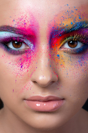 Close up view of female face with bright multicolored fashion makeup. Holi indian color festival inspired. Studio macro shot Stockfoto
