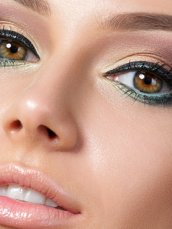 Close up beauty portrait of young woman with beautiful makeup. Studio shot. Extreme closeup, partial face view Stockfoto