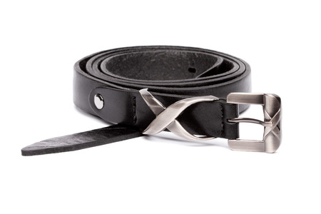 Thin black rolled belt with silver buckle isolated on white background. Studio shot Stockfoto