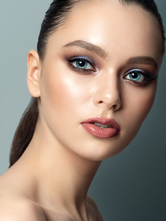 Portrait of young woman with beautiful makeup. Youth makeup concept. Studio shot Stockfoto