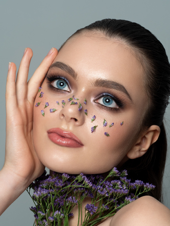 Portrait of young woman with beautiful makeup Stockfoto - 119951826