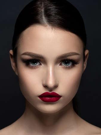 Young beautiful woman with evening makeup Stock Photo