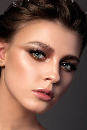 Portrait of young woman with beautiful makeup