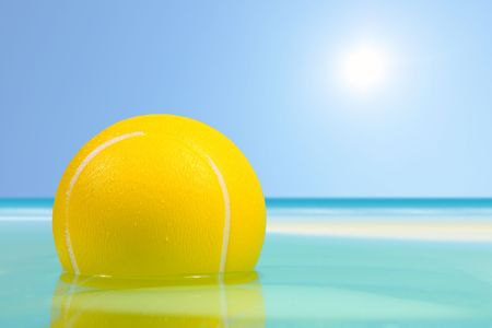 Ball floating in the sea Stock Photo