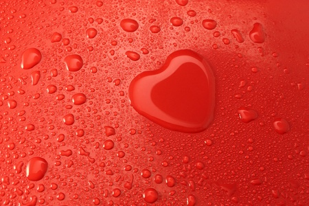 heart of water on a red surface