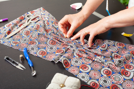 Dressmaker at work, building patterns, hands, modeling, measuring, fashion sewing machine material clothing textile Stock Photo