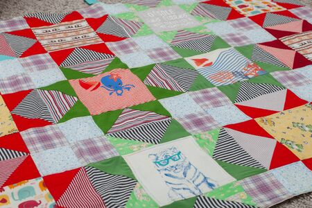 Patchwork, sewing with pieces of fabric, multi-colored segments. Imagens