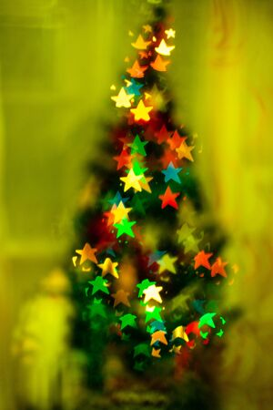 Blured sparks of light on cristmas tree, spruce lights on background