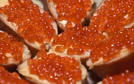 festal: sandwich with red caviar on the festal table
