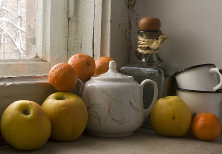 sugar apple: old still life with apples, tangerines and vintage crockery