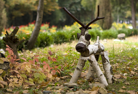folk arts - a figure of a wooden deer in the meadow Stock Photo